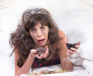 Sobbing mature woman wearing a tiara crying and tired of being alone